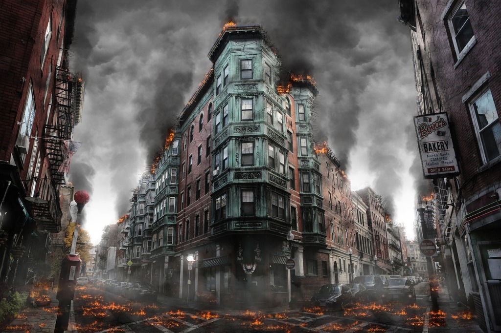 A building burns in a post-apocalyptic city. Everything is abandoned due to economic collapse.